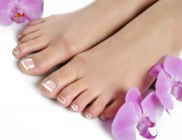 Beautiful feet with perfect spa french nail pedicure.isolated
