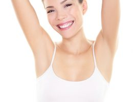 Armpit epilation hair removal woman showing armpits. Body care skincare beauty woman relaxing showing shaved armpits hairless. Happy woman with with smooth skin underarm for laser hair removal concept